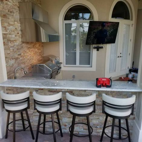Custom Outdoor Barbecue Island with Bar