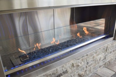 Custom outdoor fire feature cabinetry design by ELegant Outdoor Kitchens of Southwest Florida
