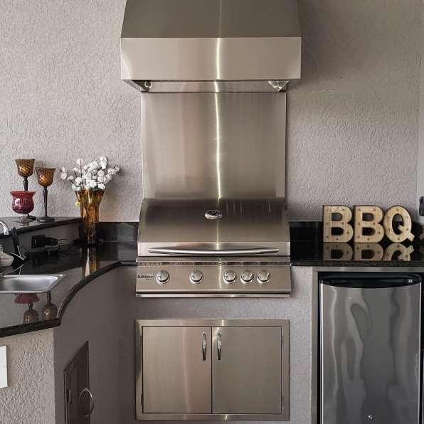 Hood installation & stainless steel backsplash in Taylor Morrison home