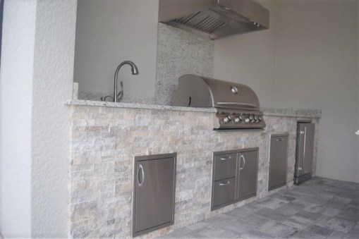 outdoor kitchen silver travertine stacked stone