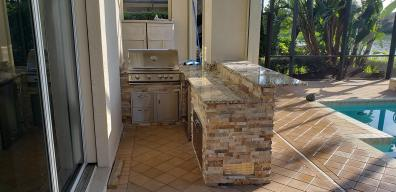 Vineyard Country Club Southwest Florida with Golden Stacked Stone and Normandy Granite