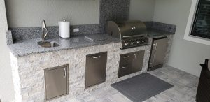 Custom Outdoor Kitchen & Outdoor Living Area Designed and Constructed by Elegant Outdoor Kitchens Of Fort Myers, Florida
