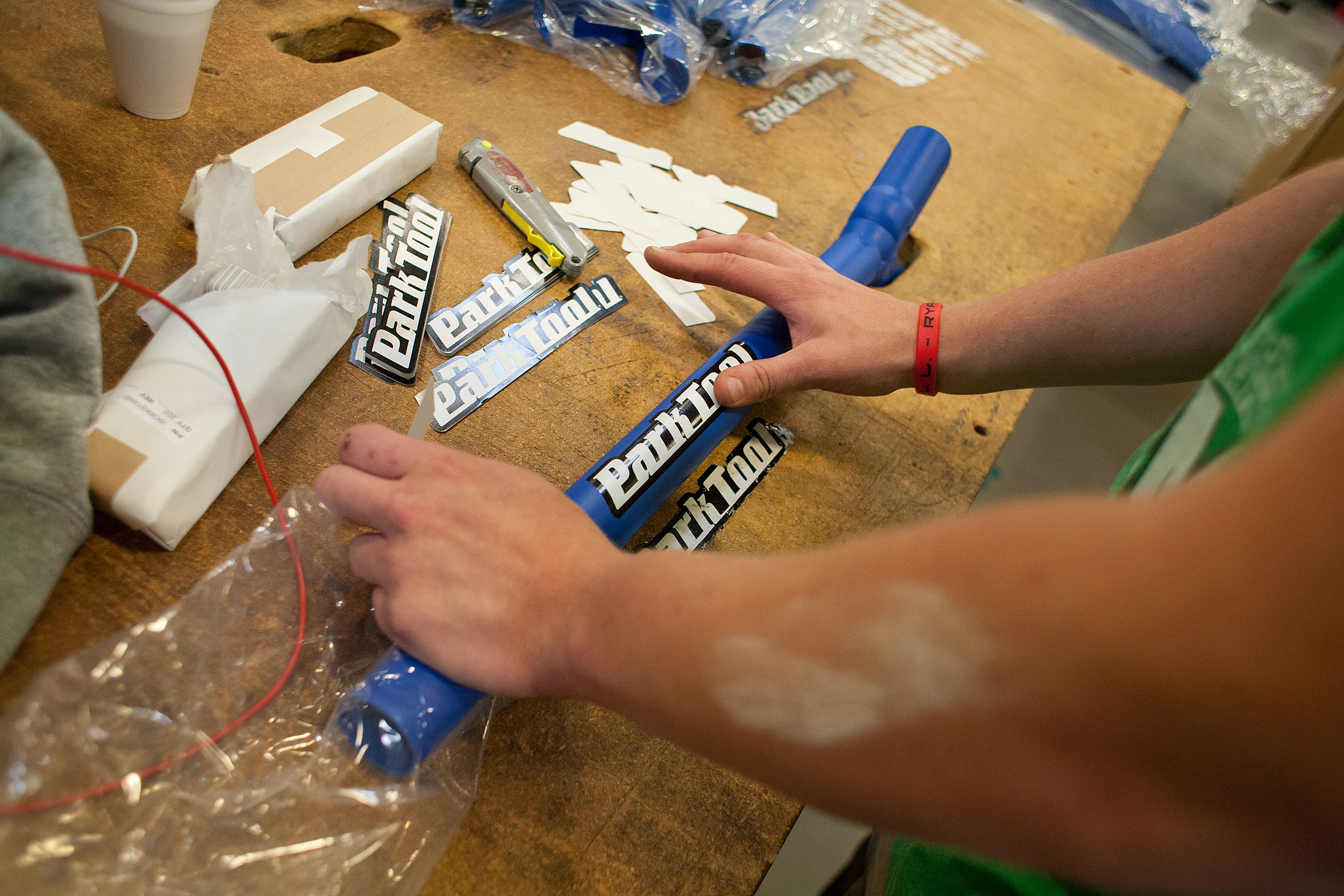 An employee affixes the Park Tool name to a product. Photo: David Pierini/Element.ly
