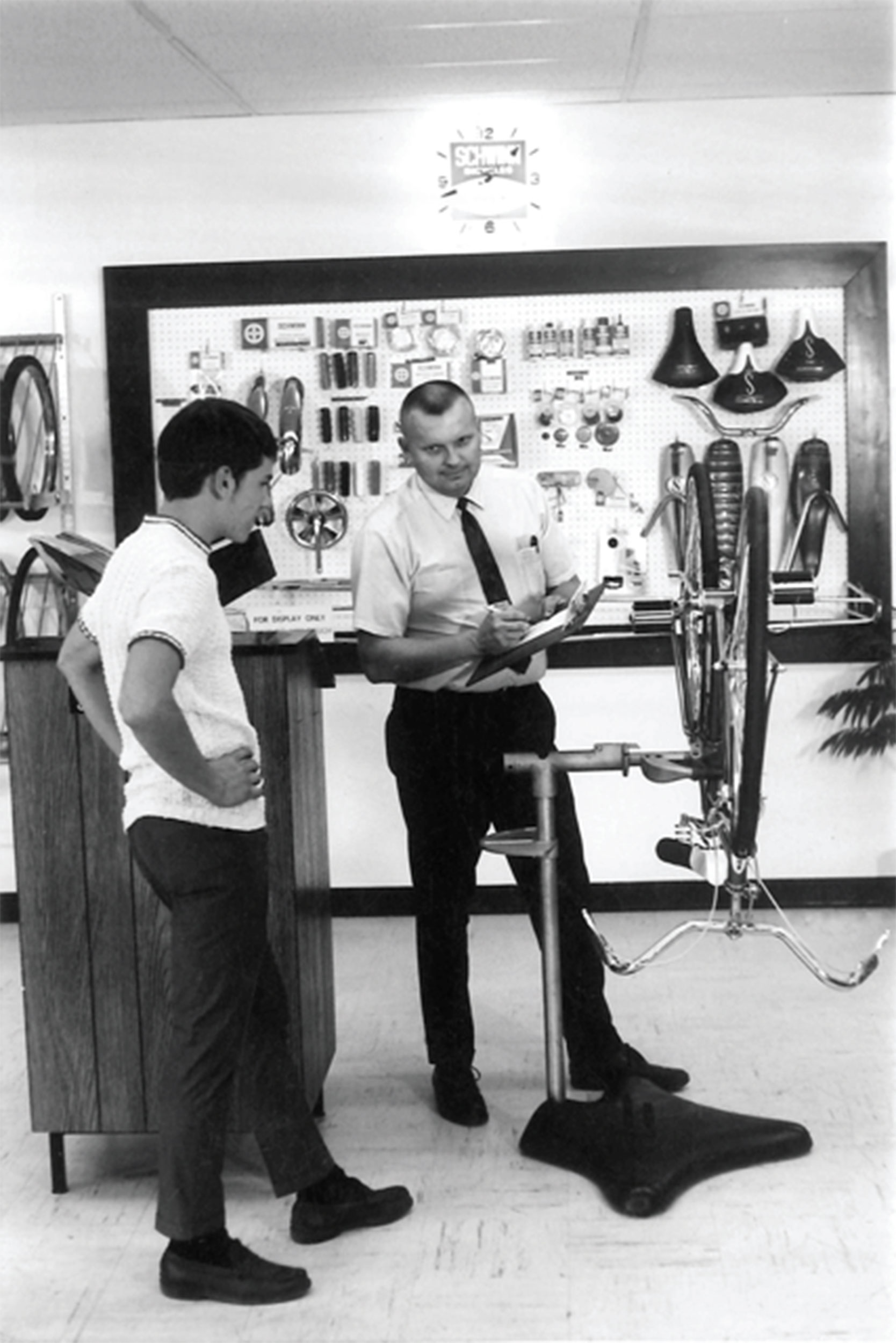 Howard Hawkins repairing a bike on the first production stand he and Art Engstrom made for Schwinn. (Courtesy of Park Tool)