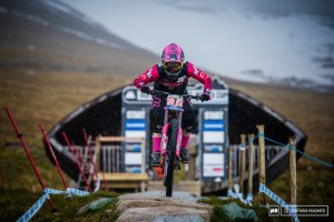 Out of the gate at into the grey with the pink. Tahnee Seagrave at Fort William start hut.