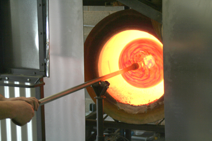 Blown glass heating in the glory hole