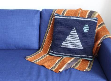 the moonrise crochet pillow on couch
