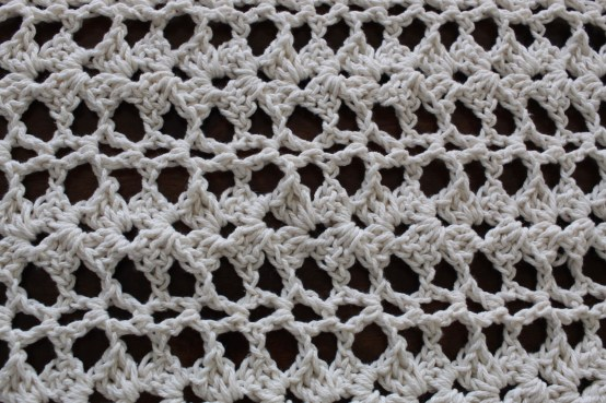 Close up of lily crochet runner
