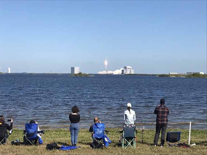 People watching a SpaceX rocket launch.
