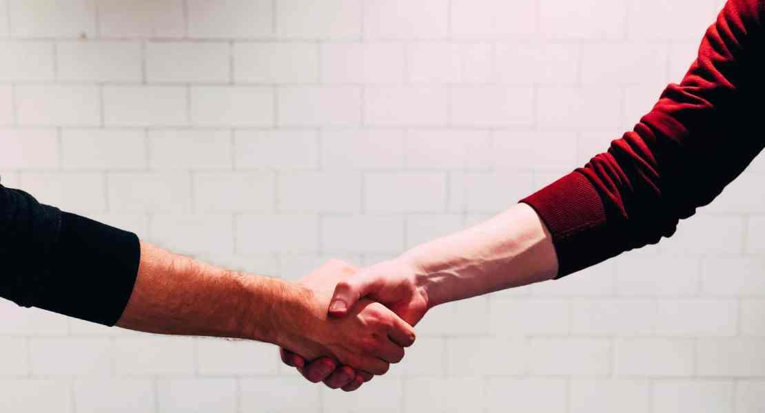 Handshake with white brick background