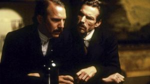 still from wyatt earp: Dennis Quaid and Kevin Costner