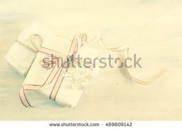 stock-photo-christmas-presents-in-rustic-style-with-holiday-decorations-selective-focus-toned-image-469609142