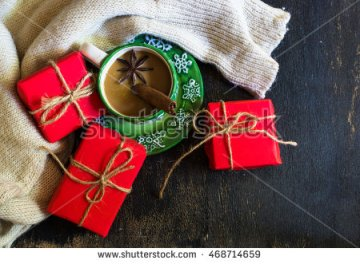 stock-photo-christmas-time-red-latern-with-candle-light-gifts-and-cup-of-coffee-with-milk-with-spices-like-468714659