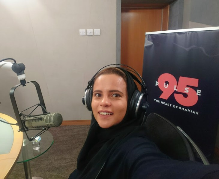 Hanady Alhashmi taking a selfie with the mic and earphones