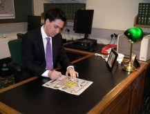 Ed Miliband reading newspaper