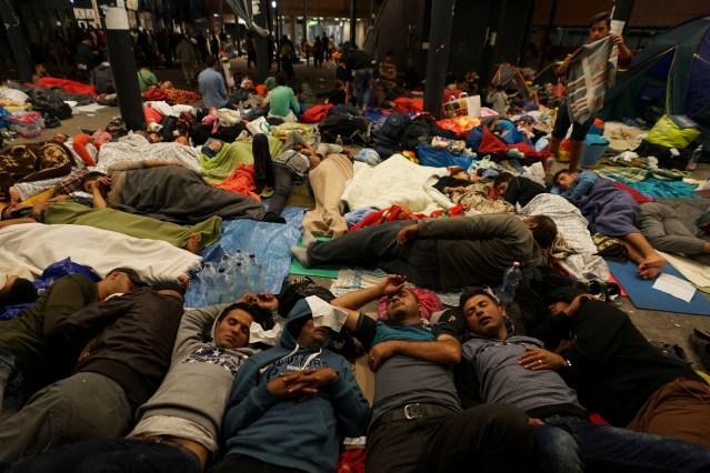 syrian_refugees_having_rest_at_the_floor_of_keleti_railway_station-_refugee_crisis-_budapest_hungary_central_europe_5_september_2015