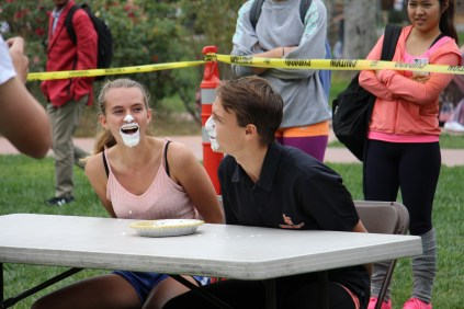 Seniors Cassandra Melax and Jimmy Gordon compete in the pie eating contest