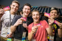 Teens pose with their food truck tickets.