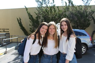 Freshman girls dressed in a trio.
