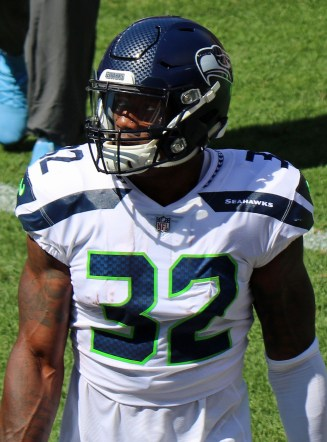 Chris Carson focuses on the scoreboard during a game.
