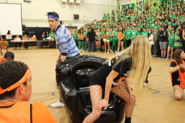 Students play musical chairs.