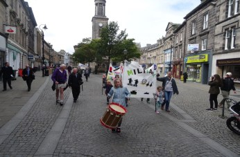 The Young Marvels march through Elgin town centre proudly displaying their trades banners.