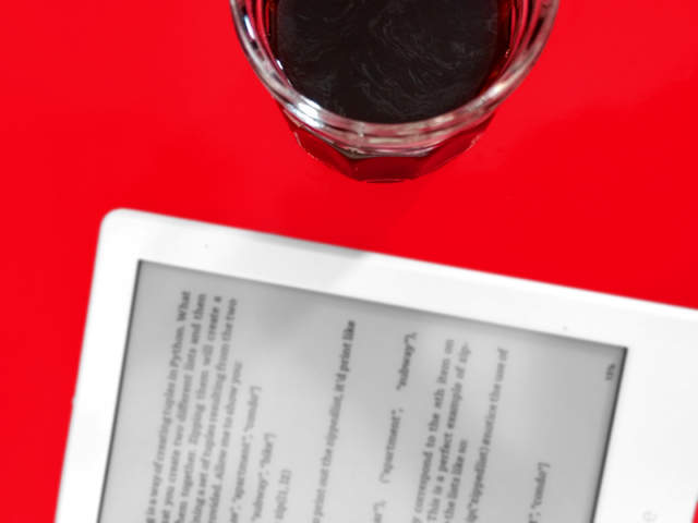 Amazon Kindle and a cup of coffee