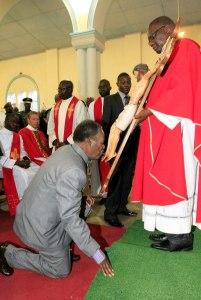 President Sata kissing the feet of Jesus