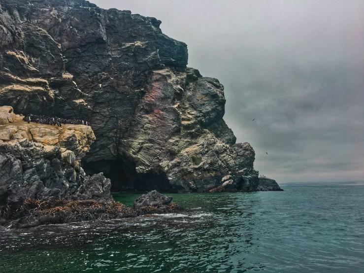 A cliff against a stormy dark sky