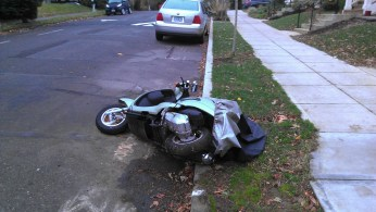 Scooter blown over by wind on Rodney.
