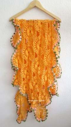orange drape on hanger
