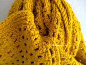 close up of mustard yellow scarf by elisabeth andrée