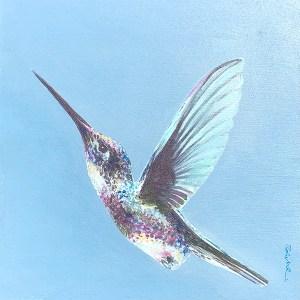 hummingbird flying upwards