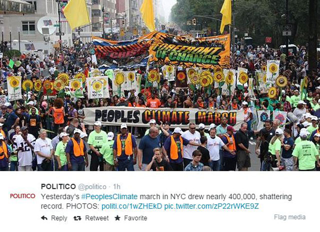 Photo People's Climate March: NYC Bright orange signs and sunflowers.