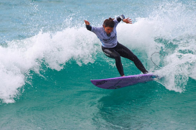 Woman surfer in competition