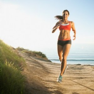 woman-running-beach-dunes