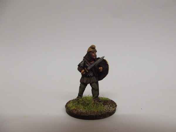 Sword and shield advancing in armour