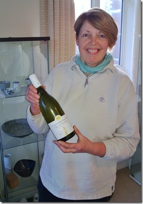 Jane Denley of Woodlands Jersey Beef with a bottle of Alain Chavy Puligny
