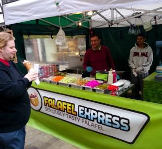 The Editor next to Falafel Express