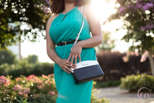 Kaela models a white and black crossbody Kate Spade bag and the Simply Chic stacked ring set. Elizabeth A. Images