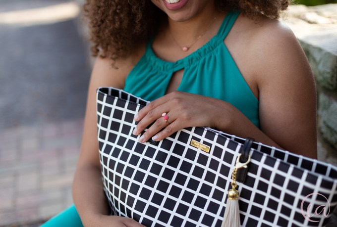 Kaela smiles as she holds a Kate Spade bag. Elizabeth A. Images