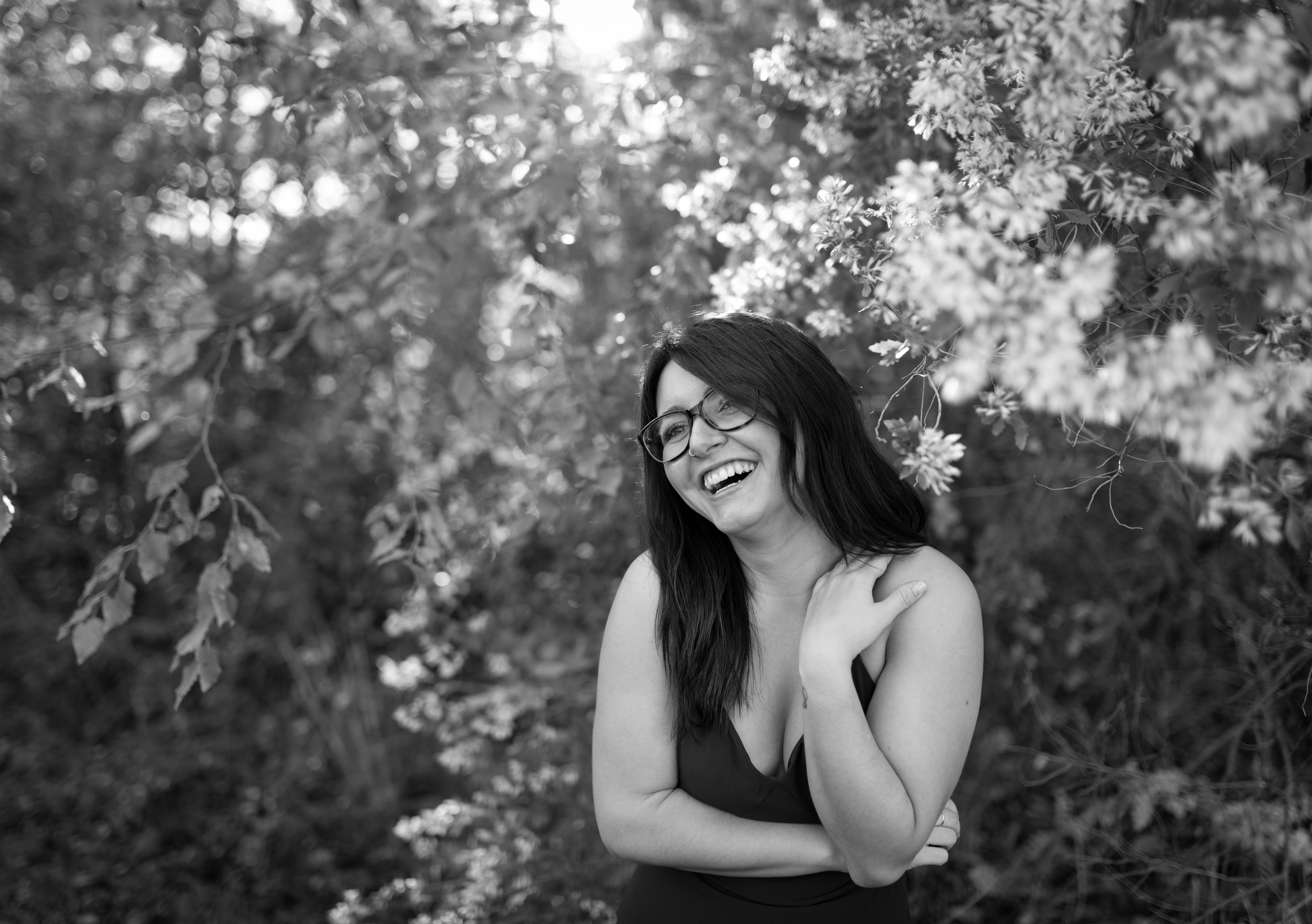 Mia laughs at something out of frame. Elizabeth A. Images CLT portrait photographer