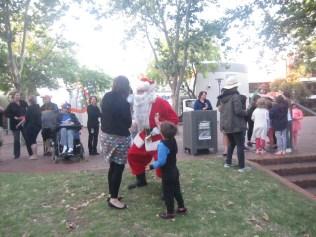 Father Christmas meeting people
