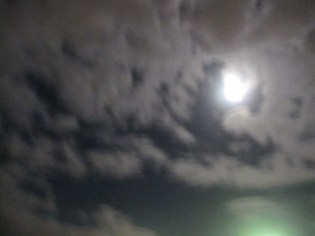 Swirling sky, moon close to full