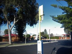 Yellow bus stop blue sky