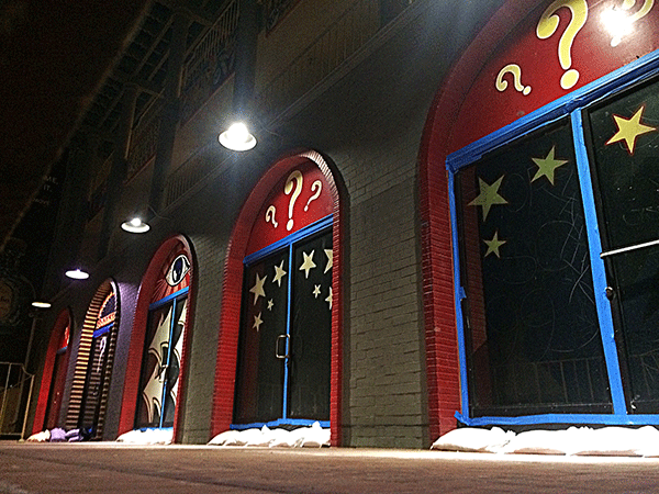 Doors near mall on Venice Beach, CA: painted red and blue with yellow stars and question marks.