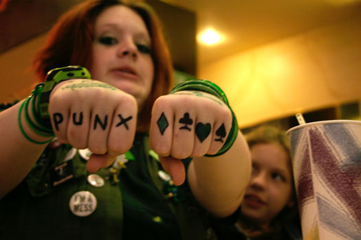 Young girl with tattooed fists