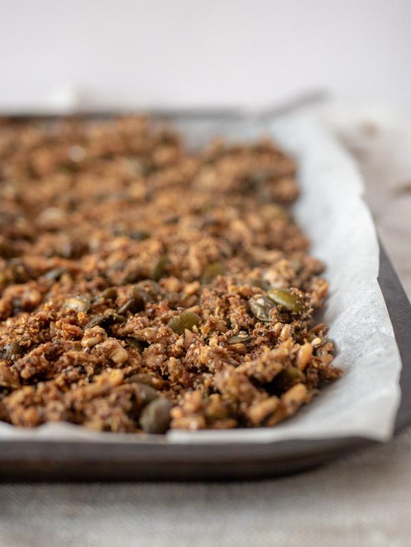 quinoa seed granola on a baking tray