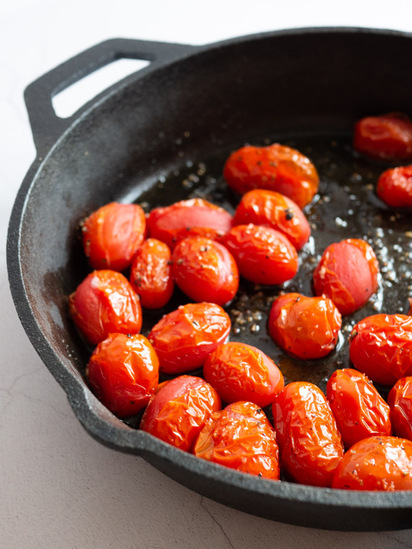 roast cherry tomatoes in a cast iron pan