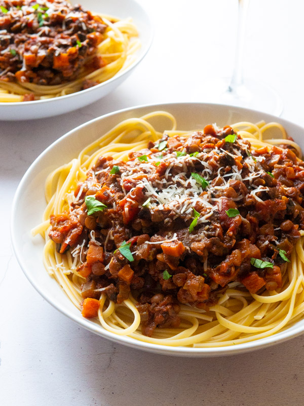 Mushroom and Lentil Spaghetti Bolognese in a white bowl